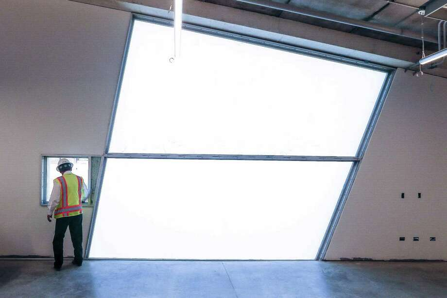 The architects were convinced that everyone wants access to fresh air; thus, the small, operable windows in each room, next to monumental glazed windows. Photo: Michael Ciaglo, Houston Chronicle / Houston Chronicle / Michael Ciaglo