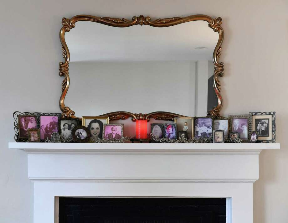 Family photos line the mantel of the Gibbs/Smith household in Arlington, Va. Photo: Washington Post Photo By Katherine Frey. / The Washington Post