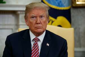 "FILE - In this April 10, 2018, file photo, President Donald Trump listens as he meets in the Oval Office of the White House, in Washington. Trump said Thursday, April 12, that an attack on Syria could take place ""very soon or not so soon at all!"" (AP Photo/Evan Vucci, File)"