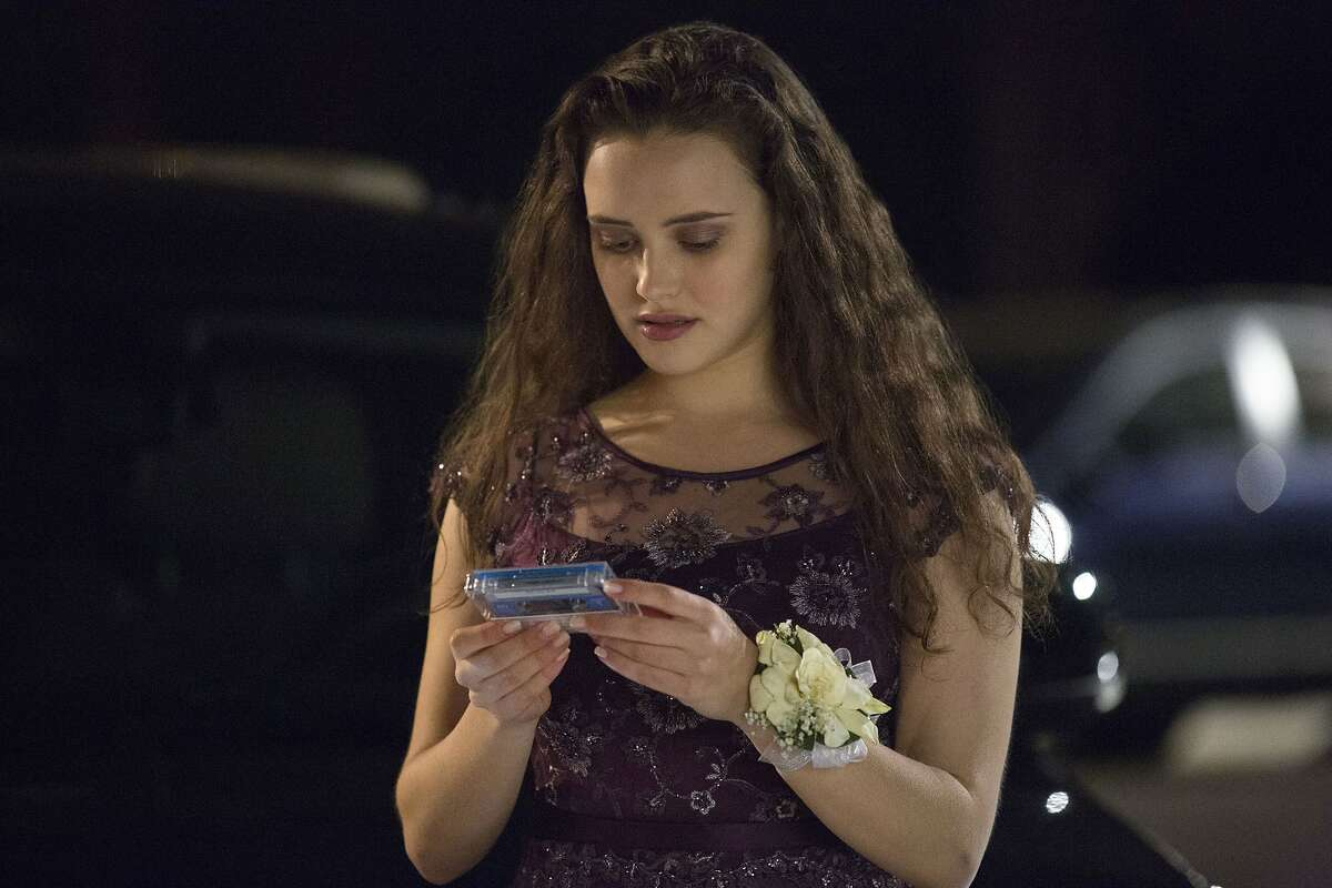 FILE - This file image released by Netflix shows Katherine Langford as Hannah Baker in a scene from the series,