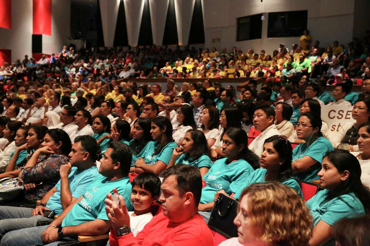 Concerned parents filled Stephen F. Austin High School auditorium for the Fort Bend ISD's final community meeting on Wednesday, April 11, 2018, in Sugar Land. The meeting was meant to review potential changes to campus attendance zones and program offerings. Many more parents had to stand or sit on the floor throughout the meeting.