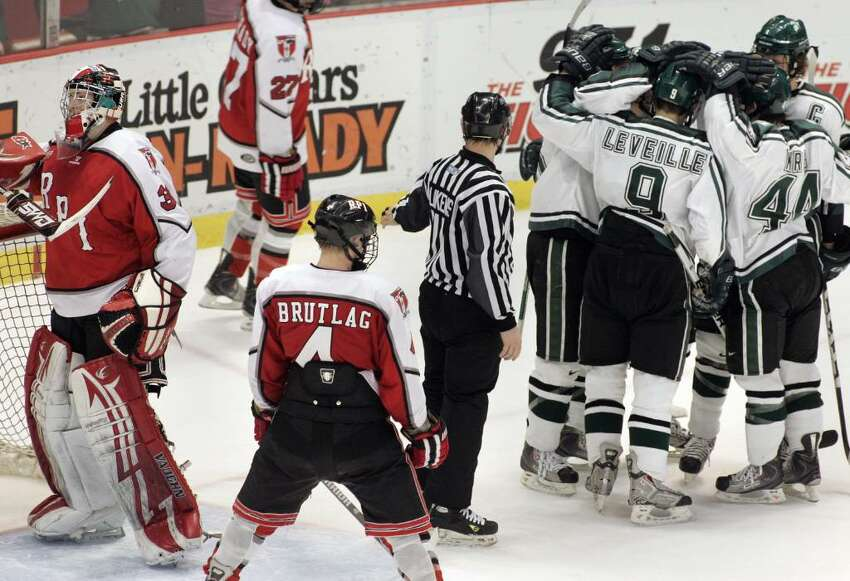 Michigan State celebrates a goal against RPI during the third period of the Great Lakes Invitational championship. (AP Photo/Jerry S. Mendoza)