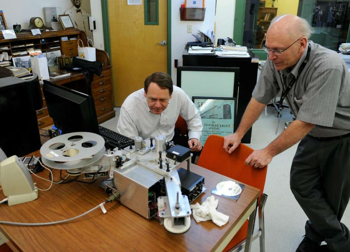Engineers John Schneiter, left, and Russell DeMuth look over the machine they built to read newly discovered optical audio film that was over 80 years old at the Schenectadyt Museum & Suits-Bueche Planetarium in Schenectady. (Skip Dickstein/Times Union)