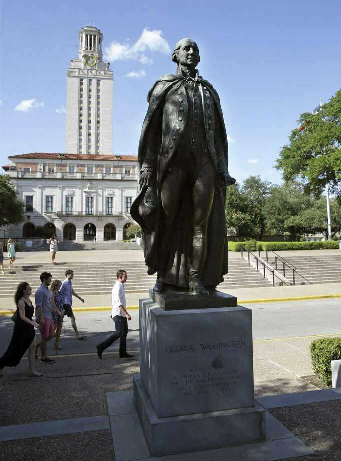 Students pass the statue of George Washington on the plaza underneath the University of Texas Tower in Austin. Universities across Texas have taken steps to become more transparent on student outcomes. For example, a landmark new tool from the University of Texas System tracks graduate salaries by major for alumni who move all over the country. Photo: Tom Reel /San Antonio Express-News / 2017 SAN ANTONIO EXPRESS-NEWS