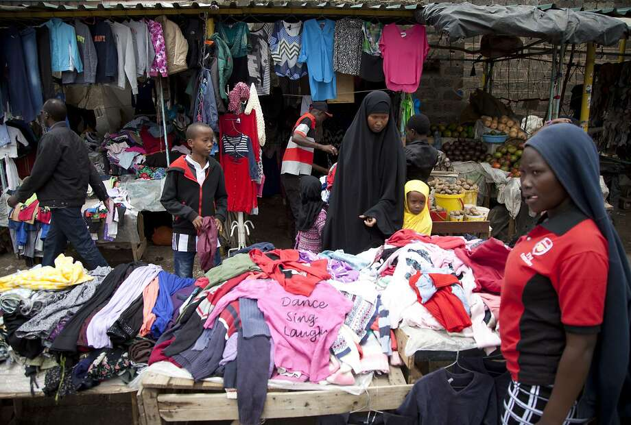 Customers look through piles of secondhand clothes at a stall in Nairobi, Kenya. Used clothes cast off by Americans has been blamed in part for undermining local textile industries. Photo: Sayyid Abdul Azim / Associated Press