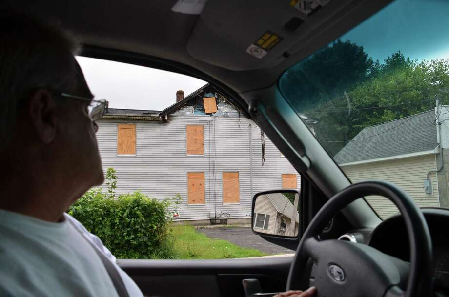 Ansonia's anti-blight officer, David Blackwell, Sr., refers to a blight site while driving through the city on Thursday, July 14, 2016. Photo: Bailey Wright / For Hearst Connecticut Media / Connecticut Post Freelance