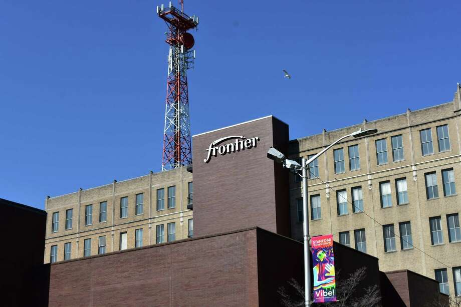 A Frontier Communications sign in downtown Stamford, Conn., in mid-April 2018. Photo: Alexander Soule / Hearst Connecticut Media / Stamford Advocate
