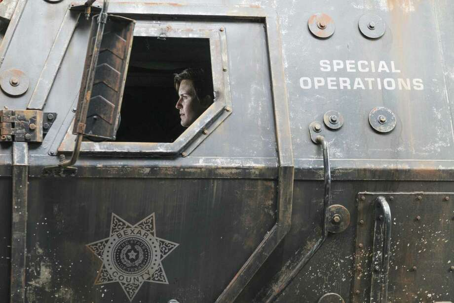 "Note the ""Bexar County"" insignia on the SWAT vehicle in ""Fear the Walking Dead,"" which is set set and primarily filmed in Austin and surrounding areas. The truck is a replica, not the real thing, but hints at an S.A.-area connection to a character's past. Photo: Courtesy Of AMC / / © 2018 AMC Film Holdings LLC. All Rights Reserved."