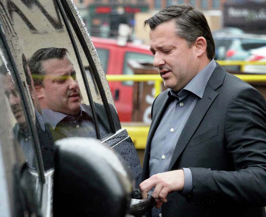 Former NASCAR racer Tony Stewart enters a waiting car following his appearance in federal court with the family of Kevin Ward Jr. to discuss a lawsuit settlement Thursday April 12, 2018 in Utica, NY.  (John Carl D'Annibale/Times Union) Photo: John Carl D'Annibale, Albany Times Union / 20043494A