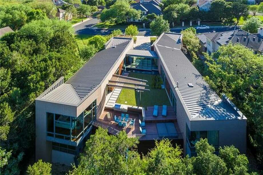 This unique 4,809-square-foot home in northwest Austin sits on an escarpment, making the surrounding neighborhood seem invisible and enhancing the sensation of floating above the trees. Photo: Realtor.com