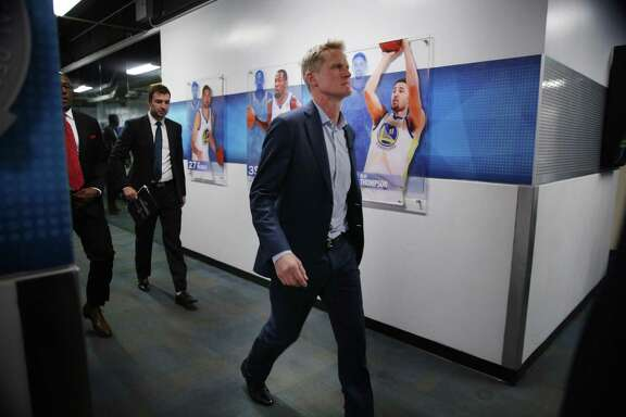 Golden State Warriors head coach Steve Kerr heads to the locker room following the NBA game between the Golden State Warriors and the Houston Rockets at Oracle Arena on Tuesday, Oct. 17, 2017, in Oakland, Calif. The Warriors lost the basketball game 122-121.