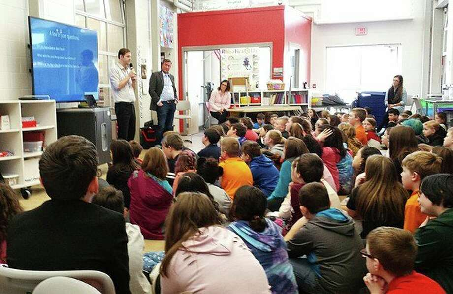 Jiri Tresl, a native of Prague and professor of finance at Central Michigan University, shares his memories of growing up in Soviet-controlled East Berlin with fifth-graders at Central Park Elementary on Thursday. (Fred Kelly/fred.kelly@mdn.net) Photo: Fred Kelly, Fred.kelly@mdn.net