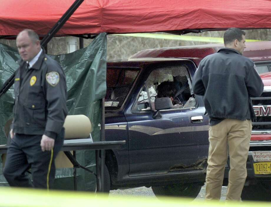 A man and a woman were found slain Thursday morning in a pickup truck near the intersection of routes 55 and 7 in Gaylordsville. Their suspected killer was found dead of a self-inflicted gunshot wound about 16 miles away, in Dover, N.Y. Photo: Carol Kaliff / Hearst Connecticut Media / The News-Times