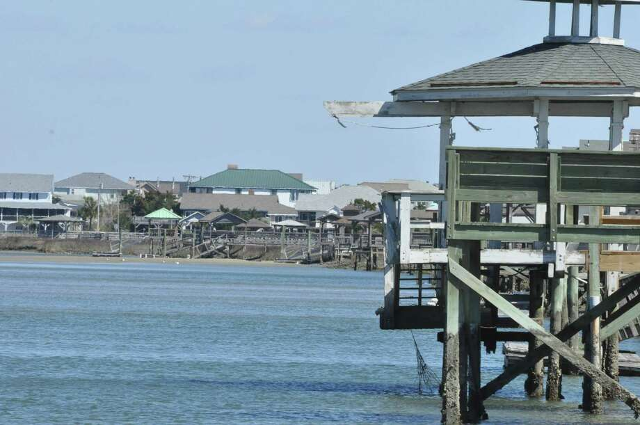 "The barrier island of Pawleys Island is less than 4 miles long and known for its dunes and surf. The area is described as ""quaint"" and ""arrogantly shabby."" The Pawleys Island website says: ""Unlike its neighboring resort islands, parts of Pawleys have changed little since the 1700s."" (Joyce Bassett/Times Union)"