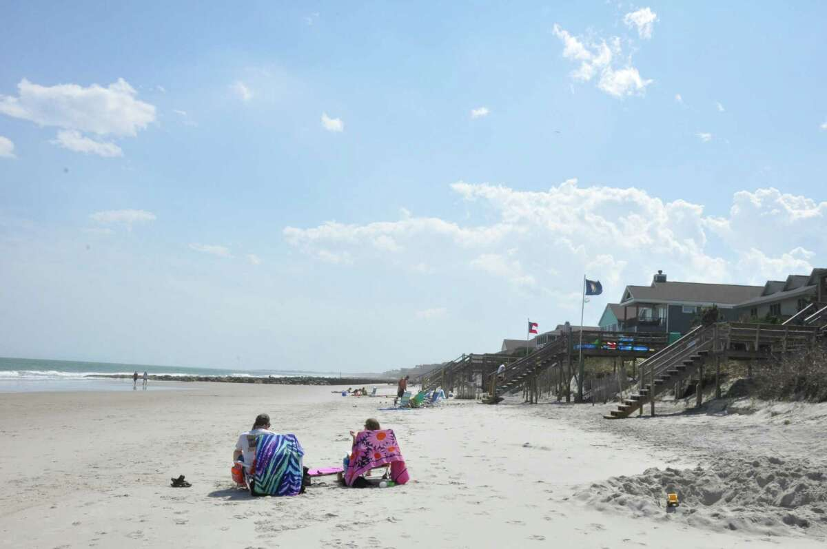 The barrier island of Pawleys Island is less than 4 miles long and known for its dunes and surf. The area is described as