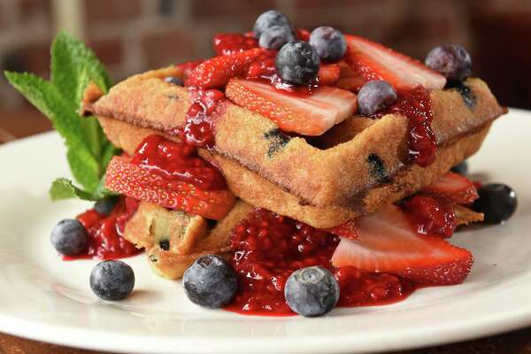Very berry: served on our homemade vegan and gluten-free waffle, double stacked, blueberries in and on each layer, fresh strawberries and raspberry compote at Iron Roost on Friday, March 30, 2018 in Ballston Spa, N.Y. (Lori Van Buren/Times Union)