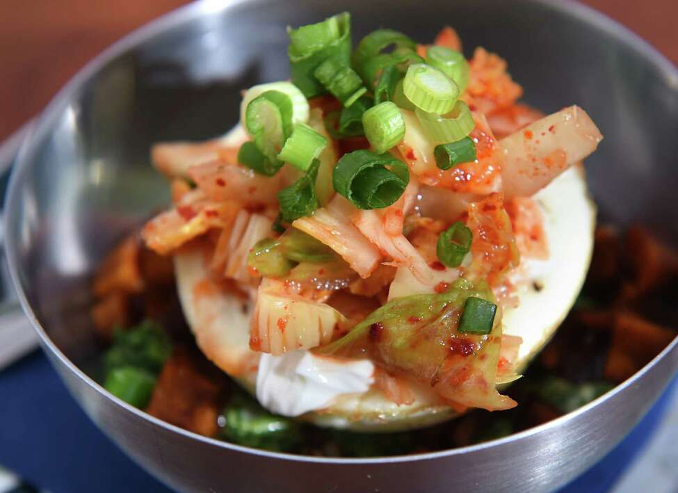 Special breakfast bowl: quinoa, tahini, arugula dressing, maple roasted turnip, soft baked egg, topped with kimchi at HiLo Cafe, Bar, Art Gallery on Thursday, March 29, 2018 in Catskill N.Y. (Lori Van Buren/Times Union)