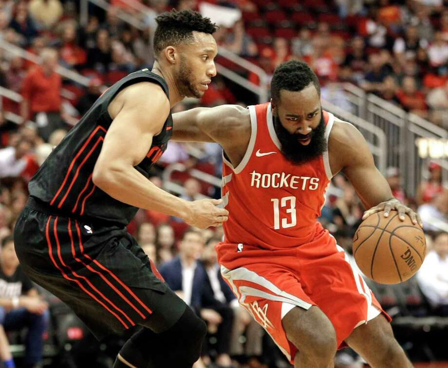 Houston Rockets guard James Harden (13) drives around Portland Trail Blazers forward Evan Turner, left, during the first half of an NBA basketball game Thursday, April 5, 2018, in Houston. (AP Photo/Michael Wyke) Photo: Michael Wyke, FRE / © Associated Press 2018