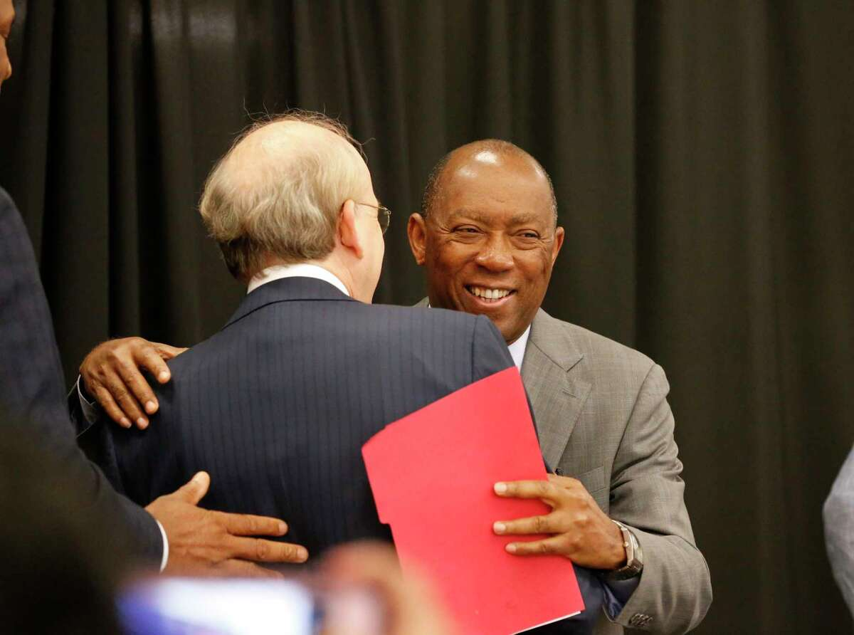 Houston Mayor Sylvester Turner hugs Rice University President David Leebron after announcing plans for Houston's Midtown innovation district in a news conference Thursday morning at the historic Sears building Thursday, April 12, 2018, in Houston.