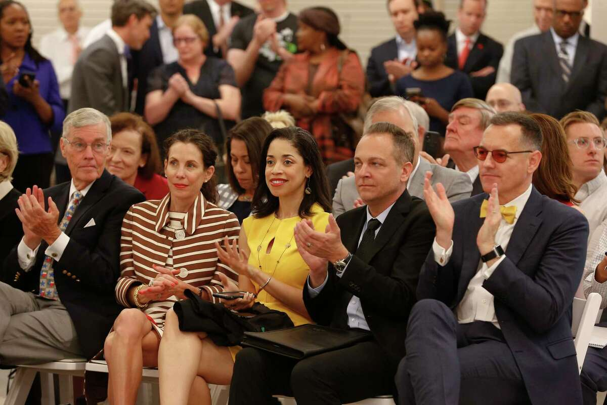 Dignitaries and guest applaud after hearing the plans for Houston's Midtown innovation district in a news conference Thursday morning at the historic Sears building Thursday, April 12, 2018, in Houston.