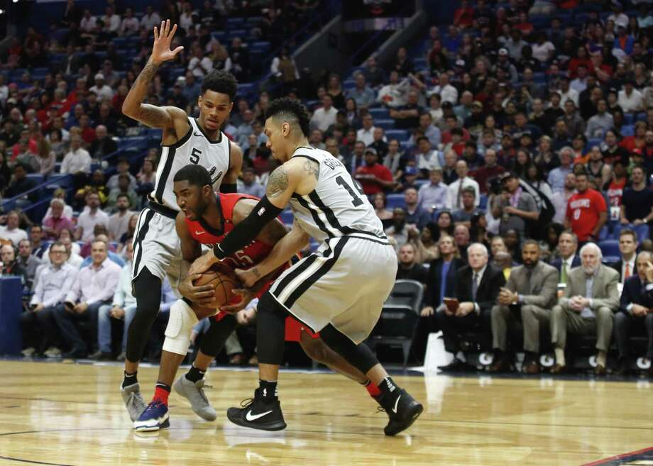 San Antonio Spurs guard Danny Green (14) steals the ball from New Orleans Pelicans forward E'Twaun Moore (55) as guard Dejounte Murray (5) defends in the first half of an NBA basketball game in New Orleans, Wednesday, April 11, 2018. (AP Photo/Scott Threlkeld) Photo: Scott Threlkeld, FRE / Associated Press / FR171144 AP
