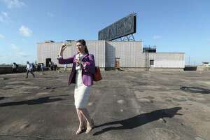 ABC-TV Reporter Courtney Fisher shoots images during a media toured the rooftop of the historic Sears building Thursday, April 12, 2018, in Houston.