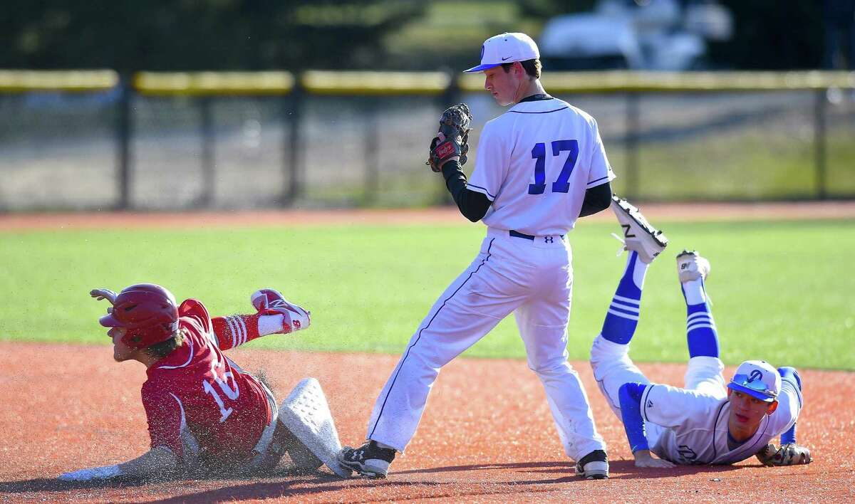 Darien's Justin Van de Graaf (17) makes the force out in the fifth inning after taking the toss from Henry Williams against NFA on April 5.