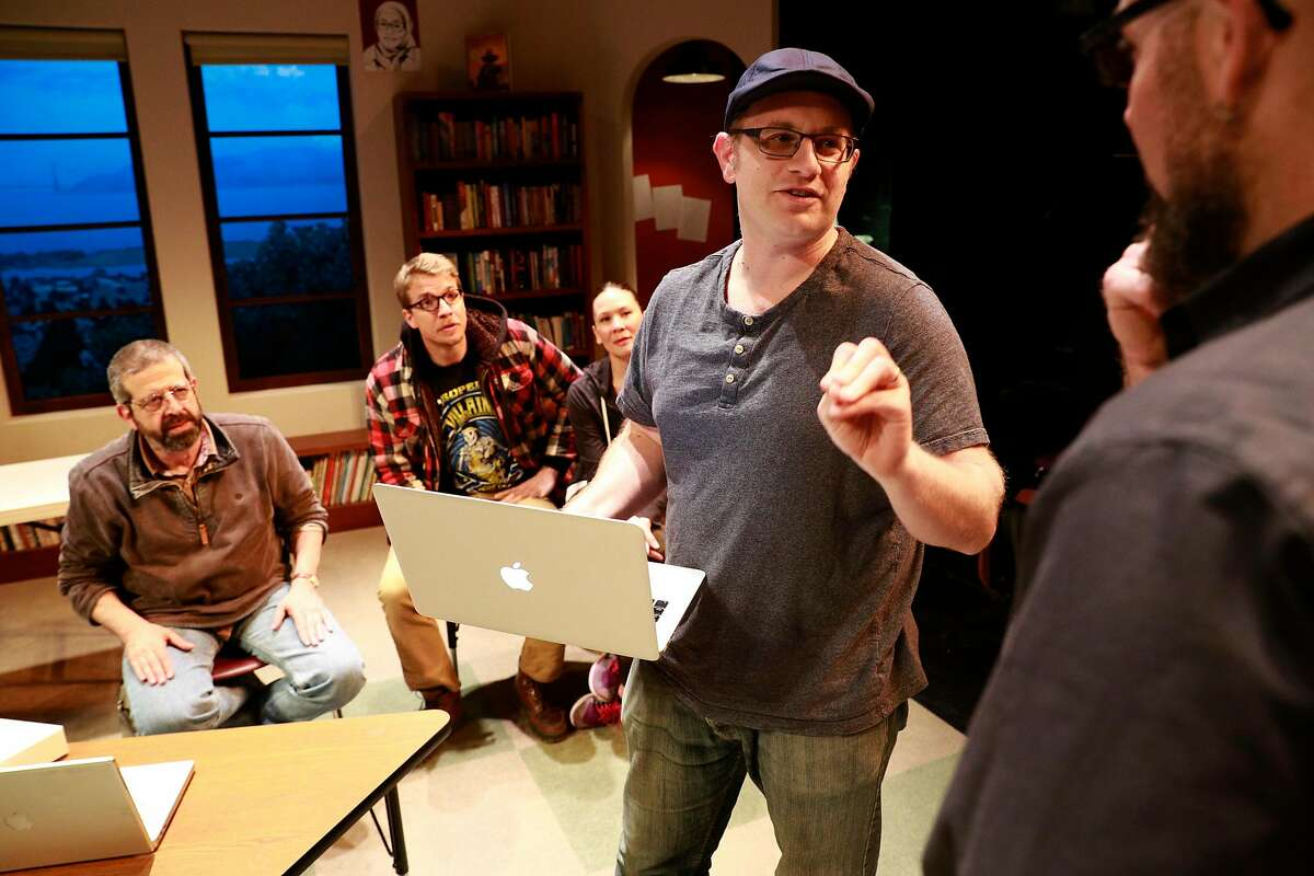"""Playwright Jonathan Spector talks with director Josh Costello, (right) along with cast members ( l to r) Rolf Saxon, Teddy Spencer and Charisse Loriaux during rehearsals on the set of """"Eureka Day"""", which will have it's world premiere at the Aurora Theatre Company as seen on Fri. April 6, 2018, in Berkeley, Calif."""