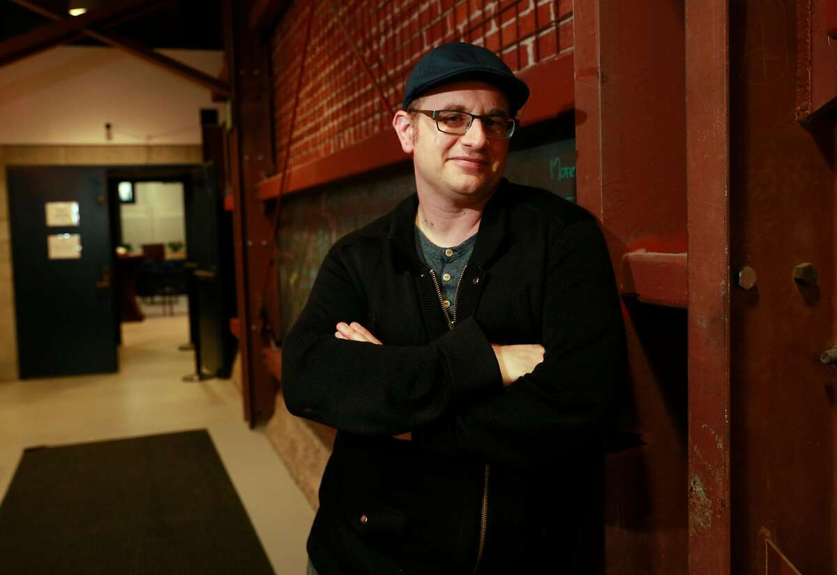 """Playwright Jonathan Spector stands at the Aurora Theatre, where he will debut the world premiere of """"Eureka Day"""", as seen on Fri. April 6, 2018, in Berkeley, Calif."""