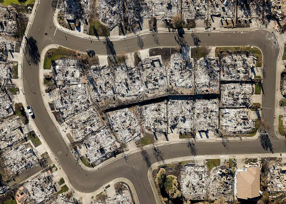 Homes leveled by the Tubbs Fire line Bella Vista Way in Santa Rosa, as seen in December. Photo: Noah Berger / Special To The Chronicle 2017