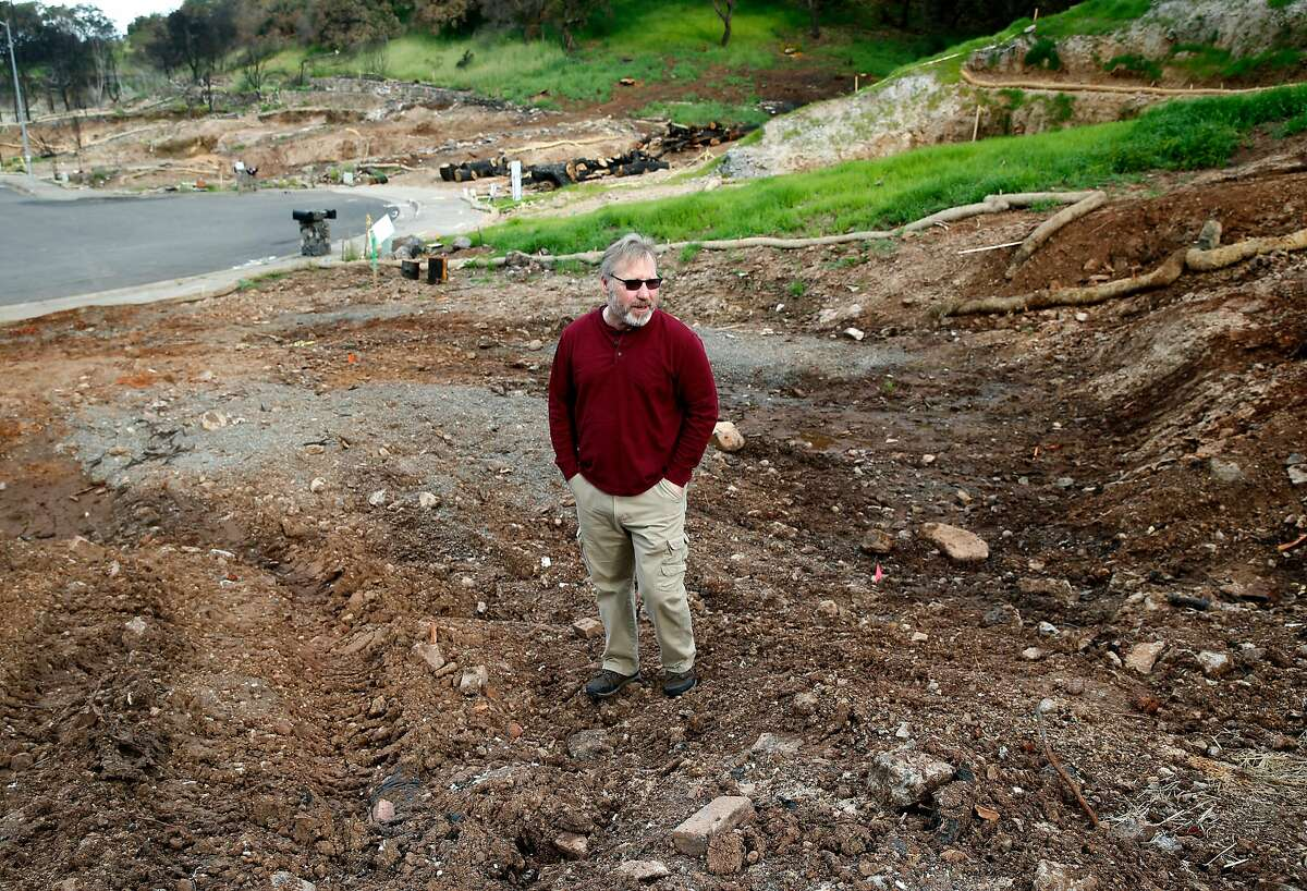 Hans Dippel visits the site of his home on Chateau Court on Wednesday, April 11, 2018 that was destroyed in the Tubbs Fire in Santa Rosa, Calif. Rebuilding the family's Fountaingrove home could be delayed because of potential contamination from underground plastic pipes, melted from the intense heat from the fire, and may have leeched benzine into the soil and water supply.