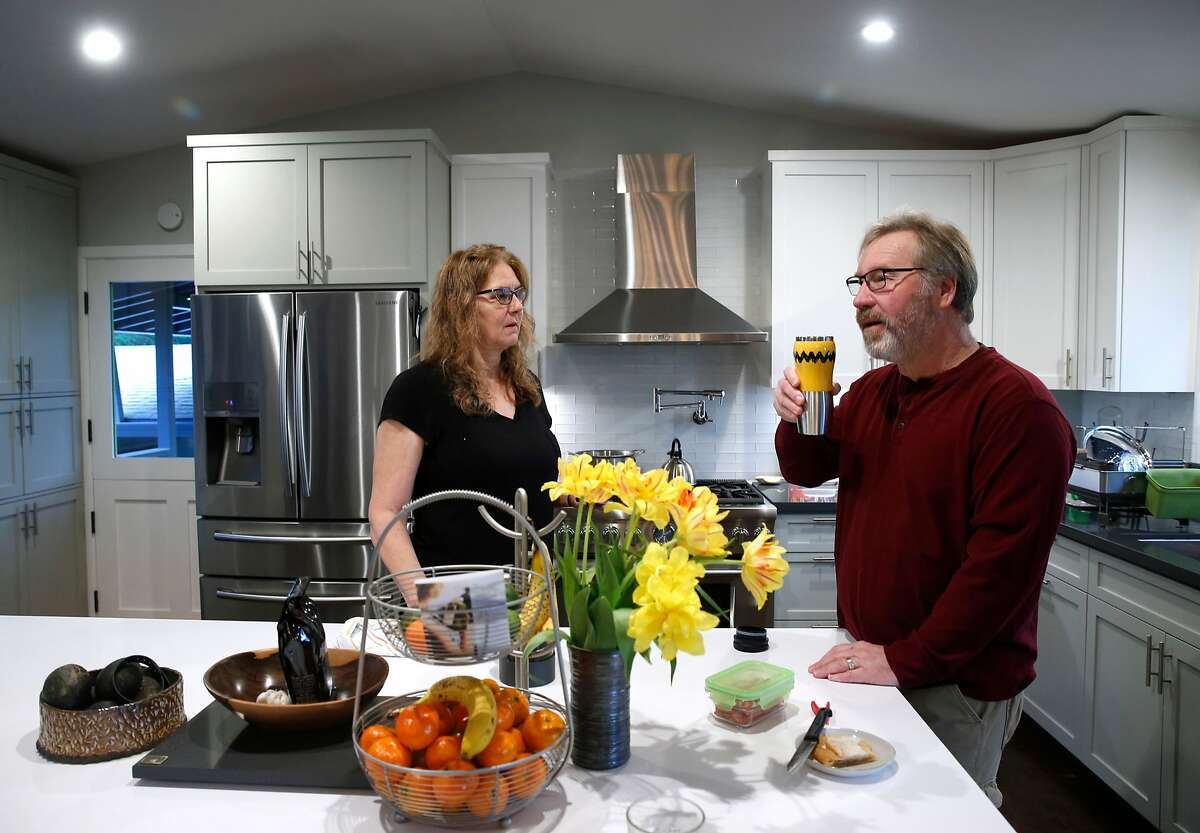 M.J. Dub� and and her husband Hans Dippel finish breakfast at their temporary rental home in Santa Rosa, Calif. on Wednesday, April 11, 2018. Rebuilding the family's Fountaingrove home that was destroyed in the Tubbs Fire could be delayed because of potential contamination from underground plastic pipes, melted from the intense heat from the fire, and may have leeched benzine into the soil and water supply.