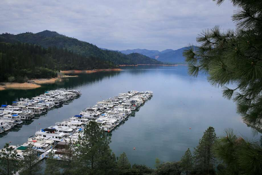 Raising Shasta Dam's height would affect businesses like the Bay Bridge Marina with its houseboats and inundate sacred Indian sites. Photo: Michael Macor / The Chronicle