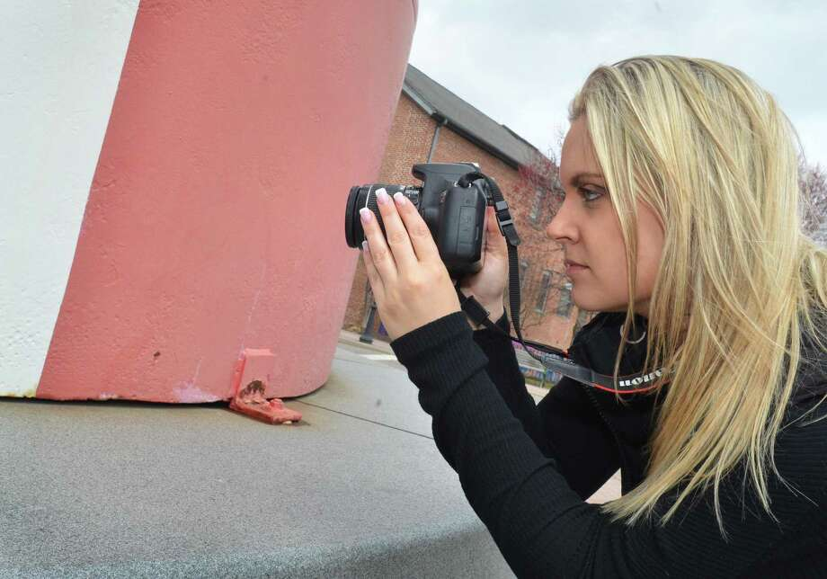 Julie Webel, Social Media Director with Norwalk Now takes a photo of an Instagram clue for the scavenger hunt  City Hunt on Tuesday April 10, 2018 in Norwalk Conn. City Hunt will allow people who download an app to rove the city performing certain tasks in order to win a prize. Photo: Alex Von Kleydorff / Hearst Connecticut Media / Norwalk Hour