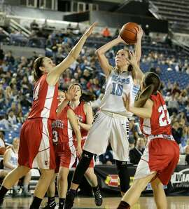 Central Valley's Lexie Hull (10) puts up a shot against Snohomish in the second half of the Washington state girls 4A high school basketball championship, Saturday, March 5, 2016, in Tacoma, Wash. Central Valley beat Snohomish 57-48. (AP Photo/Ted S. Warren)