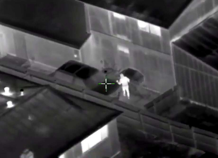 Screenshot of a video of Stephon Clark shooting where officers fatally shot the unarmed black man who was holding his cellphone in his grandparents' backyard.  The Sacramento Police Department has released helicopter (Sacramento Police Department) Photo: Sacramento Police Department