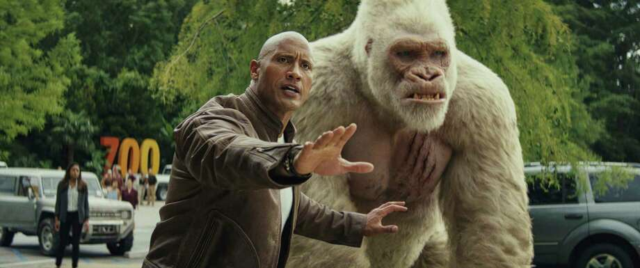 """This image released by Warner Bros. shows Dwayne Johnson in a scene from """"Rampage."""" (Dwayne Johnson via AP) / © 2018 Warner Bros. Entertainment Inc. and RatPac-Dune Entertain"""