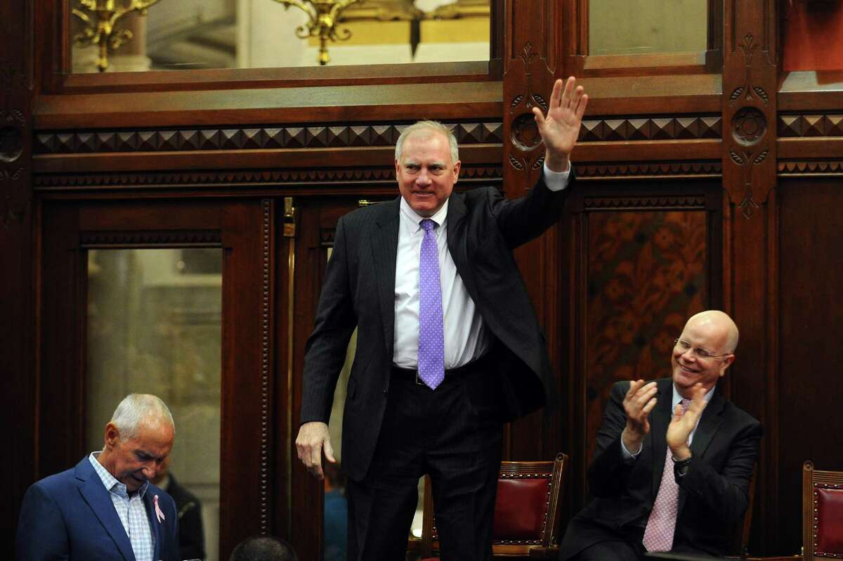 Connecticut Attorney General George Jepsen waves before Gov. Dannel Malloy's State of the State address at the State Capitol in Hartford, Conn., on Feb. 7, 2018. Jepsen belongs to a coalition of state attorneys general investigating pharmaceutical companies including Stamford-based Purdue Pharma.