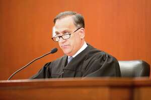 Superior Court Judge Thomas Moukawsher reads a 254-page ruling on an 11-year-old lawsuit Connecticut Coalition for Justice in Education Funding v. Rell, Sept. 7, 2017 at the Hartford Superior Court. Moukawsher is hearing this year litigation filed by Connecticut cities and towns against pharmaceutical companies including Purdue Pharma.