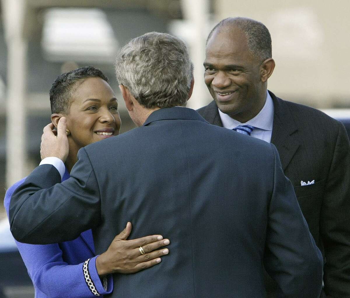 President Bush is welcomed to Houston after landing at Ellington Field by Pastor Kirbyjon Caldwell, right, and his wife Suzette at left, Friday, Sept. 12, 2003. President Bush will promote his faith-based initiative as he lends support to The Power Center, a huge multi-use complex celebrating ten years of community service in southwest Houston, run by Caldwell and business owners. (AP Photo/J. Scott Applewhite)