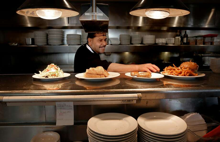 Cooks at Buttercup Diner in Oakland will be able to share in tips under a new federal law that changes how staffs are paid. Photo: Photos By Michael Macor / The Chronicle