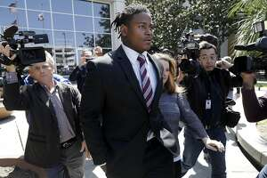 San Francisco 49ers linebacker Reuben Foster, center, exits the Santa Clara County Superior Court after his arraignment, Thursday, April 12, 2018, in San Jose, Calif. Foster has been charged with felony domestic violence after being accused of attacking his girlfriend, authorities said. (AP Photo/Marcio Jose Sanchez)