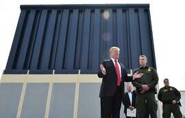 "US President Donald Trump speaks during an inspection of border wall prototypes in San Diego, California on March 13, 2018. Donald Trump -- making his first trip to California as president -- warned there would be ""bedlam"" without the controversial wall he wants to build on the border with Mexico, as he inspected several prototype barriers. The trip to the ""Golden State"" -- the most populous in the country and a Democratic stronghold -- was largely upstaged by his own announcement that he had sacked Secretary of State Rex Tillerson.  / AFP PHOTO / MANDEL NGANMANDEL NGAN/AFP/Getty Images"