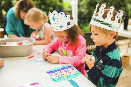 The Fiesta Arts Fair brings in about $200,000 annually for the Southwest School of Art, which hosts the two-day event. Here, children create in the Young Artist Garden, where little ones can pursue their muse in a variety of media.