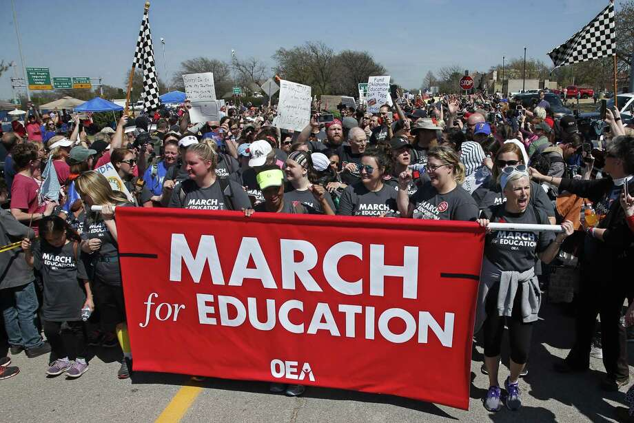 Marchers cheer as they cross the finish line at the state Capitol after marching 110 miles from Tulsa, Okla., as protests continue over school funding, in Oklahoma City, Tuesday, April 10, 2018. (AP Photo/Sue Ogrocki) Photo: Sue Ogrocki, STF / Associated Press / AP2018