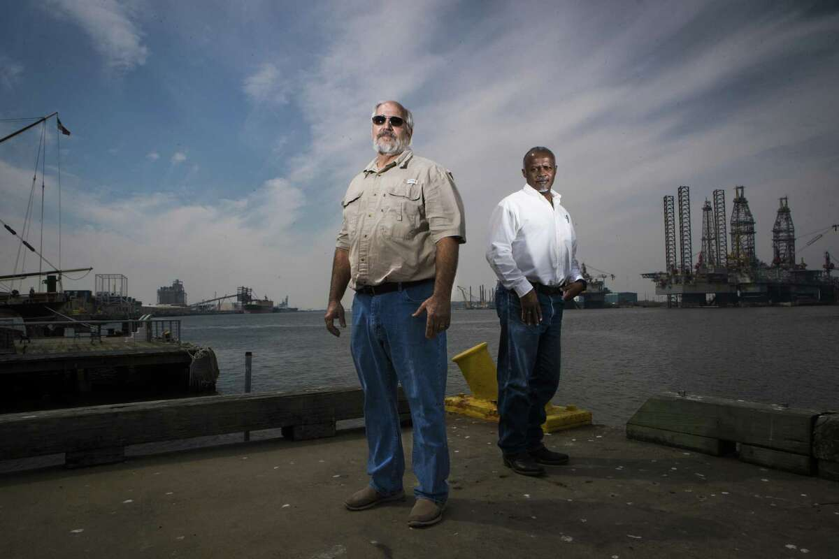 Federally licensed pilots, Capt. Jay Heichelheim, left, and Capt. Graylin Gant stand at Pier 21 near where ships dock in Galveston, Thursday, March 8, 2018. Heichelheim and Gant are part of a lawsuit attempting to authorize a second state-licensed pilot group to guide ships to Galveston and Texas City docks. ( Marie D. De Jesus / Houston Chronicle )