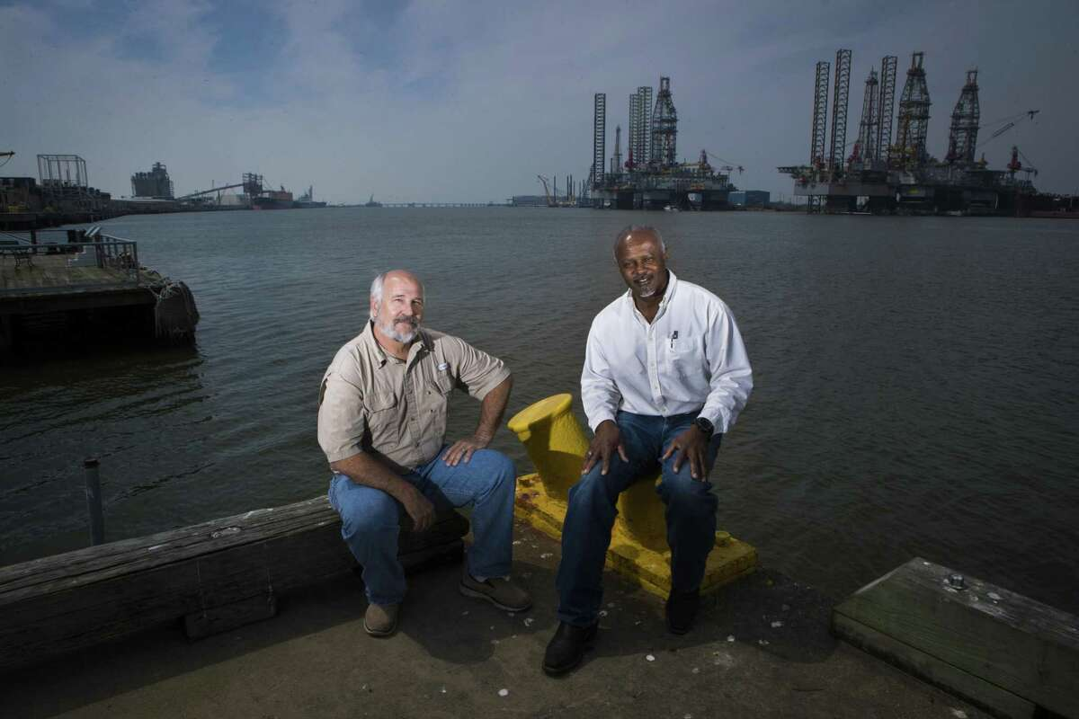 Federally licensed pilots, Capt. Jay Heichelheim, left, and Capt. Graylin Gant sit at Pier 21 near where ships dock in Galveston, Thursday, March 8, 2018. Heichelheim and Gant are part of a lawsuit attempting to authorize a second state-licensed pilot group to guide ships to Galveston and Texas City docks. ( Marie D. De Jesus / Houston Chronicle )