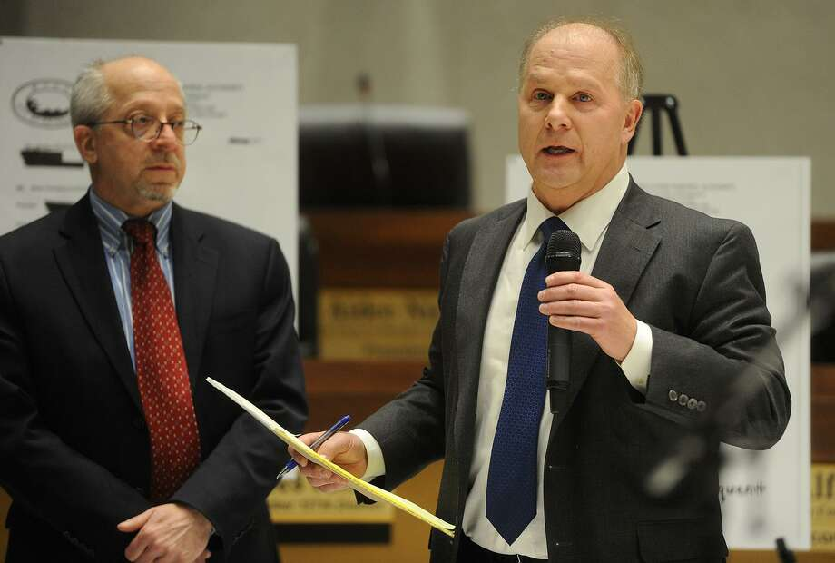 City Attorneys Russell Liskov, left, and Christopher Meyer deliver a presentation on how the Water Pollution Control Authority collects unpaid sewer bills to the Bridgeport City Council at City Hall in Bridgeport, Conn. on Monday, January 29, 2018. Photo: Brian A. Pounds / Hearst Connecticut Media / Connecticut Post