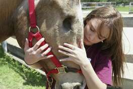 Kayla Reinagel, who is legally blind, savors a quiet moment with her horse, Tonka, before committing to the Schreiner University equestrian team. A reader praises a recent column on the special bond between the girl and her horse.