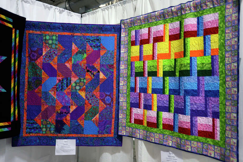"Quilts on display at the Golden Triangle Quilt Guild's ""Color Your World"" quilt show at Ford Park. The show will be held Friday and Saturday with quilts on display in a juried show and vendors selling their quilts and supplies.  Photo taken Thursday 4/12/18 Ryan Pelham/The Enterprise Photo: Ryan Pelham / ©2018 The Beaumont Enterprise/Ryan Pelham"